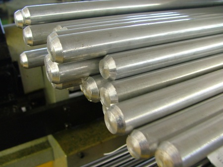 Steel bars pointed in preparation for precision machining. miles