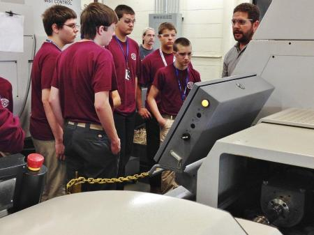 EMC Precision  Opens shop to students and community