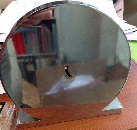 Pipe steel centerline defect in wrought steel bar. We had this specimen hard chrome plated and made it into a bookend.