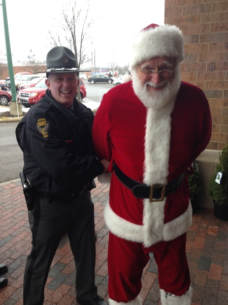 No telling on what the State troopers busted this jolly old elf for, but we bailed him out with donations to the local food bank...