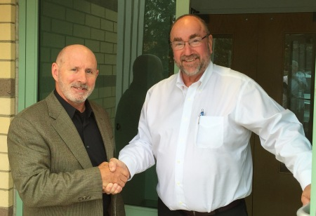 Bernie Nagle (left) is welcomed to PMPA Headquarters by PMPA President Tom Bernstein